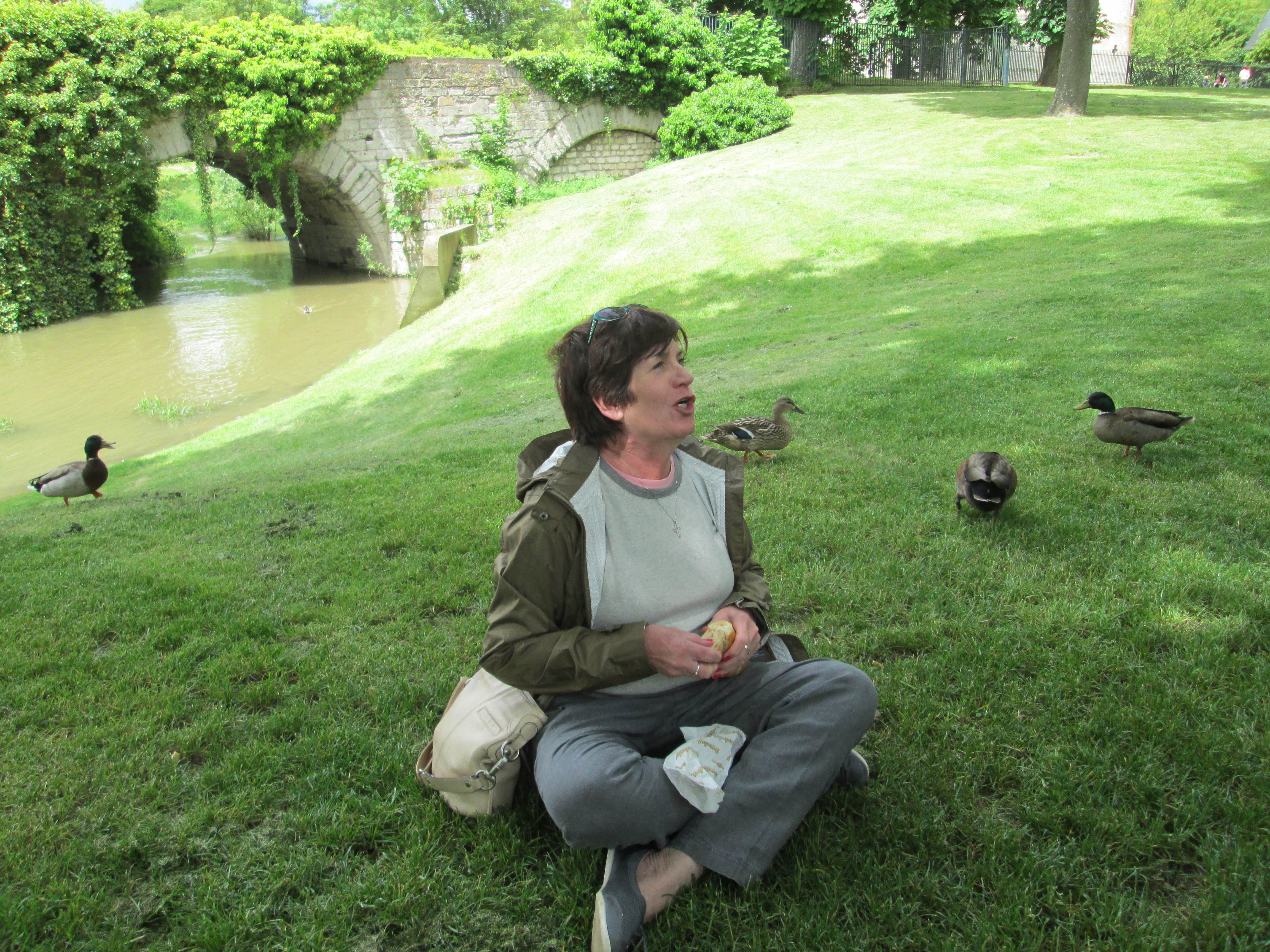 Therese picnicking with ducks in Vernon